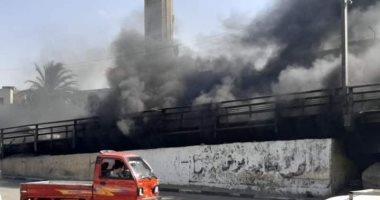 صورة السيطرة على حريق مخلفات أسفل كوبرى السيدة زينب.. صور