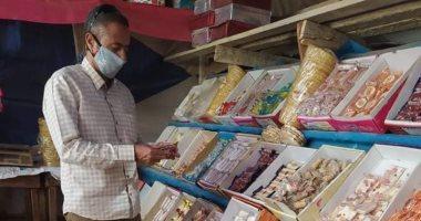 إعدام أغذية غير صالحة فى حملات على محلات حلوى المولد بنى سويف.. صور
