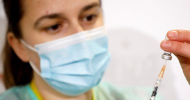 فيروس كورونا والكمامة - أرشيفية