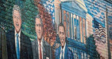 دستور أمريكا وجرافيتى الرؤساء وصور بايدن وكامالا هاريس تزين مطاعم وشوارع واشنطن..ألبوم صور