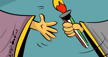 كاريكاتير صحيفة كويتية: الحكومة الجديد تتسلم شعلة مسيرة البناء والتنمية