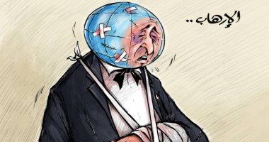 العالم يعانى من جروح خطيرة بسبب الإرهاب فى كاريكاتير إماراتى