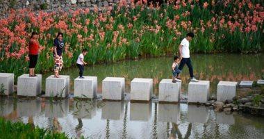 بعد الجليد طبيعة ساحرة.. البحيرات الجليدية فى الصين تعلن ذوبانها وتستقبل زوارها