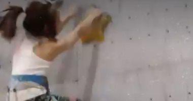 """""""نسخة من سبايدر مان"""".. طفلة صينية تتسلق جدار بطول 12مترا في11ثانية .. فيديو"""