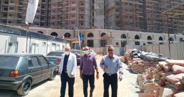 """مسئولو """"الإسكان"""" يتابعون سير العمل بالأبراج السكنية والاستثمارية بمثلث ماسبيرو"""