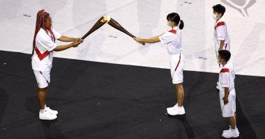 صورة نعومى أوساكا تشعل الشعلة الأولمبية فى حفل افتتاح أولمبياد طوكيو2020
