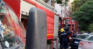 السيطرة على حريق فى عقار بالدقى.. صور