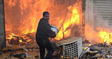 """ملثمون يحرقون سيارات بـ""""جراج"""" وحدة"""