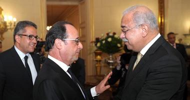 بالصور.. رئيس الوزراء يلتقى الرئيس الفرنسى فرانسوا هولاند