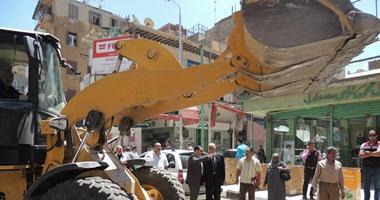 مدير بورسعيد يقود حملة لإزالة