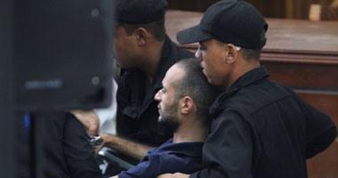 أحمد دومة.. على كرسى متحرك  أثناء محاكمته فى أحداث مجلس الوزراء