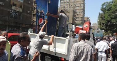 أمن الجيزة يواصل حملاته لإزالة تعديات شارع عثمان محرم بالطالبية