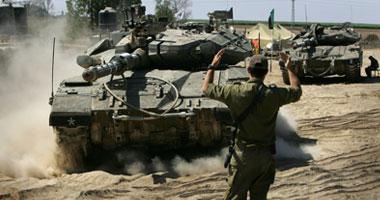 دبابات إسرائيلية تتقدم نحو غزة والطيران يقصف حى الزيتون S12200830141435.jpg