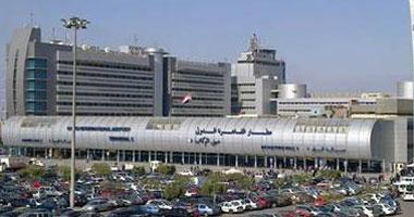 ضبط ساعات ونظارات وطائرة مزودة بكاميرات تجسس مع راكبة بالمطار