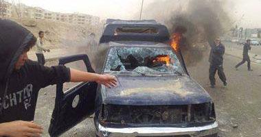 سيارة شرطة محترقة