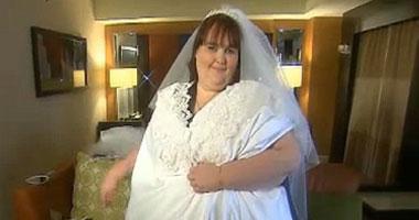 بالصور.. أكبر فستان زفاف لعروس وزنها 350 كيلو  S520121201441