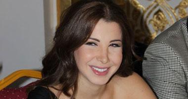 بالصور نانسى عجرم تتألق فى حفل افتتاح المجمع التجارى بتركيا2011 s10201116111250.jpg