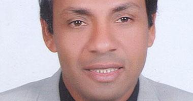 د. جمال محمد على الفائز بعمادة كلية التربية