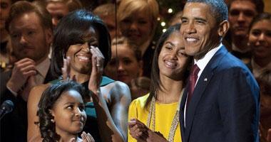 بالصور.. أوباما وعائلته يشاركون فى احتفالية عيد الميلاد بواشنطن s1220111212327.jpg