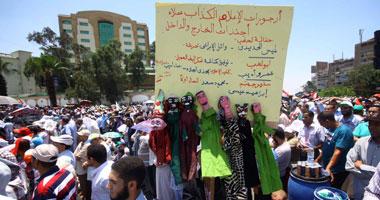 """بالصور.. متظاهرو """"رابعة العدوية"""" يرفعون لافتة كبيرة تطالب بتطهير الإعلام"""
