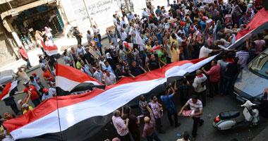 متظاهرو التحرير يقفون دقيقة حدادا
