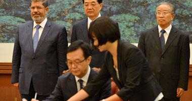 الرئيسان مرسى وتاو يشهدان توقيع 7 اتفاقيات بين مصر والصين