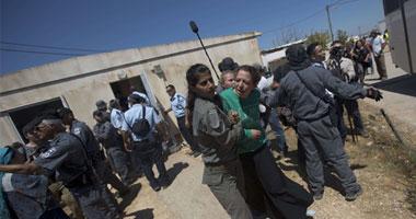 الاصرار على هضم الحق الفلسطينى من مستوطنون ميجرون - بالصور S920123111127