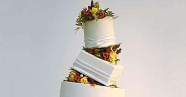 بالصور.. أحدث تصميمات كعك الزفاف لفصل الصيف Smal6201025155027