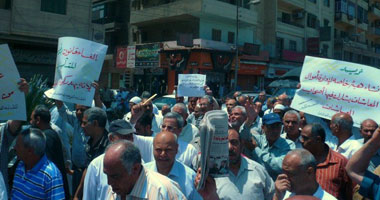 تظاهر أصحاب المعاشات بالمحلة للمطالبة باسترداد 438 مليار جنيه Smal6201117161840
