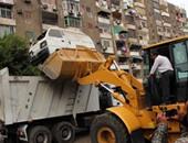 رئيس حى الساحل: تطبيق غرامات رصف وإشغال طريق على أصحاب مخازن الخردة
