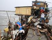 """بالصور.. إعصار """"كوبو"""" يضرب الفلبين والآلاف يفرون من منازلهم"""