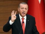 """بالصور..أردوغان يتجاهل الخراب فى تركيا ويرفع شارة """"رابعة"""""""