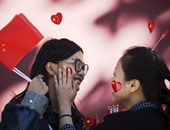 الصينيون يحتفلون بالذكرى الـ66 لتأسيس الجمهورية
