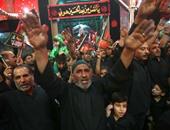 شعارات معارضة لانفصال كردستان خلال احياء عاشوراء فى كربلاء