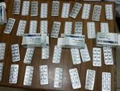 المعمل الجنائى يفحص كمية من الأقراص المخدرة ضبطت بحوزة عاطل بأبو النمرس