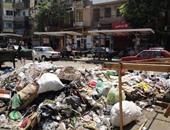 """صحافة المواطن: تلال قمامة ومياه المجارى تحاصر """"بنك الإسكان"""" ببورسعيد"""
