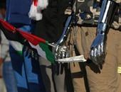 """بالصور.. مانيكان الملابس فى غزة يدعم أبطال عمليات الطعن بـ""""سكين وعلم"""""""