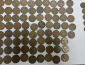 ضبط 18 عملة معدنية يشتبه فى أثريتها بمطار برج العرب بالإسكندرية