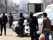 الأمن يطلق قنابل الغاز لفض اشتباكات الإخوان والأهالى فى منطقة فيصل