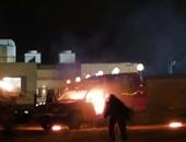 مجهولون يشعلون النيران فى سيارة شرطة بأكتوبر