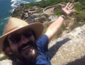 """أحمد حلمى ينشر صورة له على طريقة السيلفى من """"آخر نقطة فى إفريقيا"""""""