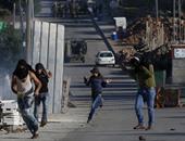 بالصور.. إصابة فلسطينيين برصاص قوات الاحتلال فى مواجهات ببلعين غرب رام الله