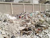 شكوى من تراكم أكوام القمامة بشارع ترعة عبد العال فى فيصل