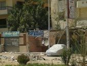 بالصور.. أستاذة بحقوق القاهرة تشتكى من الإهمال بحى حدائق الأهرام