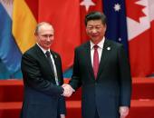 الرئيسان الصينى والروسى يتعهدان بالعمل على ترسيخ الأمن والاستقرار فى ٢٠١٧