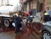 محافظة الجيزة تزيل آثار دماء ذبح أضاحى العيد من الشوارع