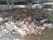 قارئ يرصد انتشار القمامة فى شارع مراد أسفل كوبرى الجيزة