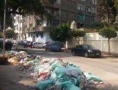 تراكم أكوام القمامة أمام مدرسة جيهان السادات الثانوية بالروضة