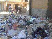 """بالصور.. تلال القمامة تحاصر """"قصر ثقافة"""" فرشوط"""