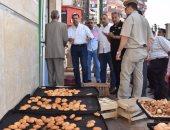 محافظ أسيوط يغلق جمعية ومخبز سياحى وسوبر ماركت لتعديهم على الطريق العام